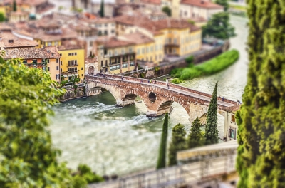Ancient Roman Bridge in Verona, Italy. Tilt-shift effect applied