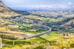 S-Curve highway overpass in a scenic valley near Segesta, Sicily, Italy. Tilt-shift effect applied