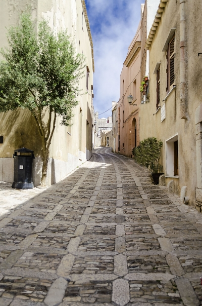 Stone paved ancient street in Erice, Sicily, Italy