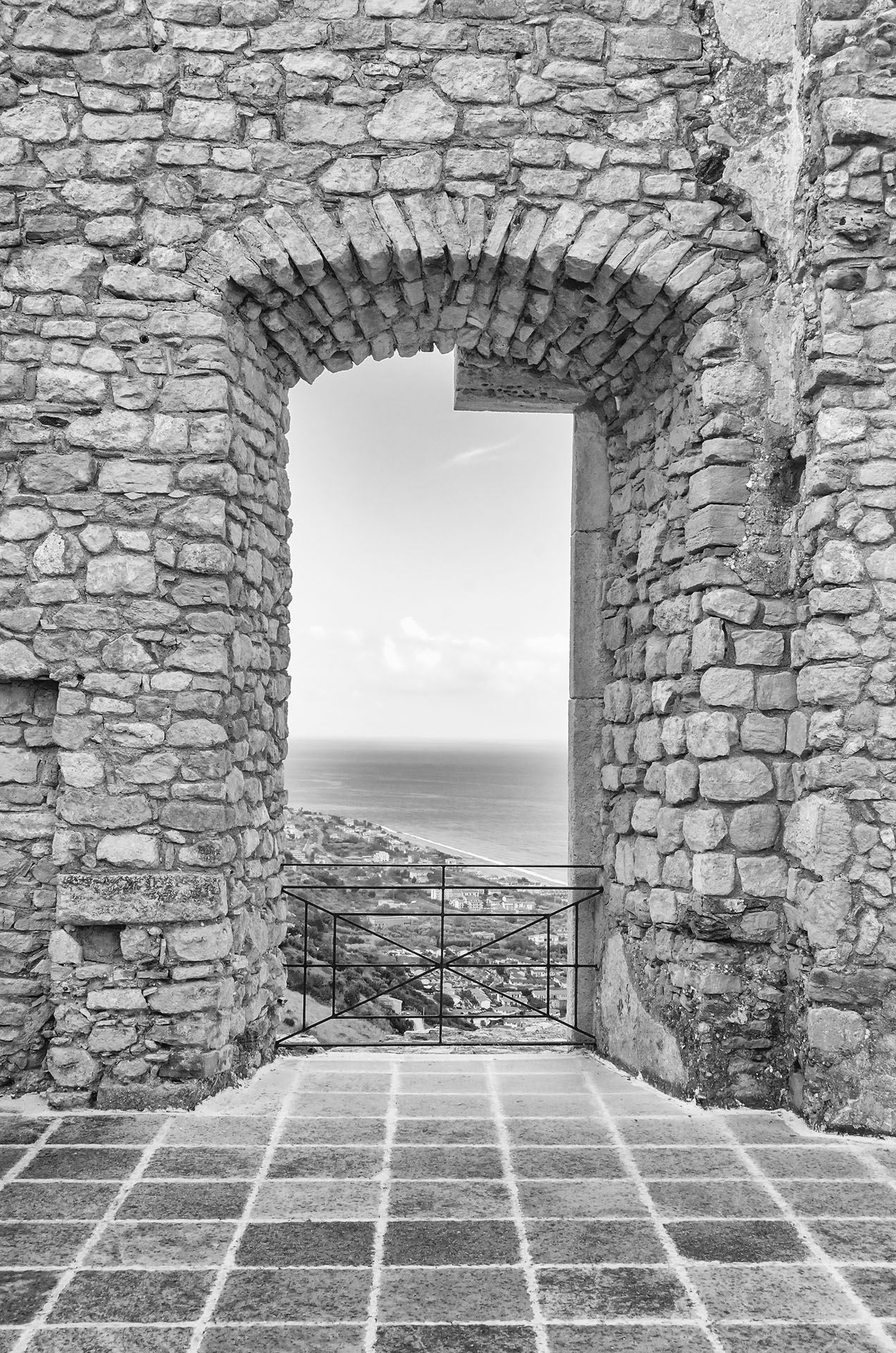 Ancient window among ruins of an old castle with seascape