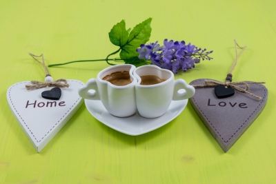 Breakfast composition of two espresso cups and flower