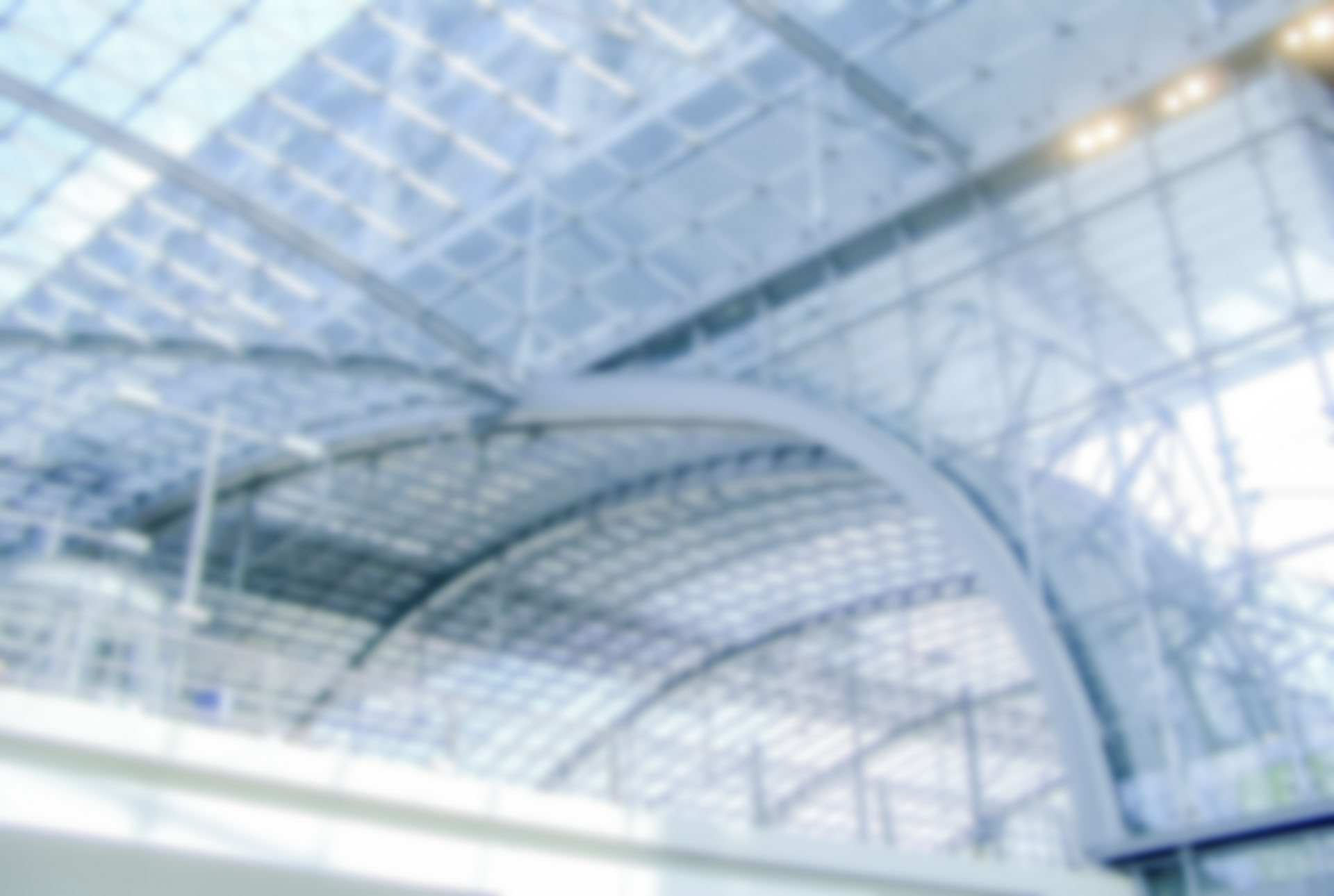 Defocused background with interiors of Berlin Main Train Station. Intentionally blurred post production