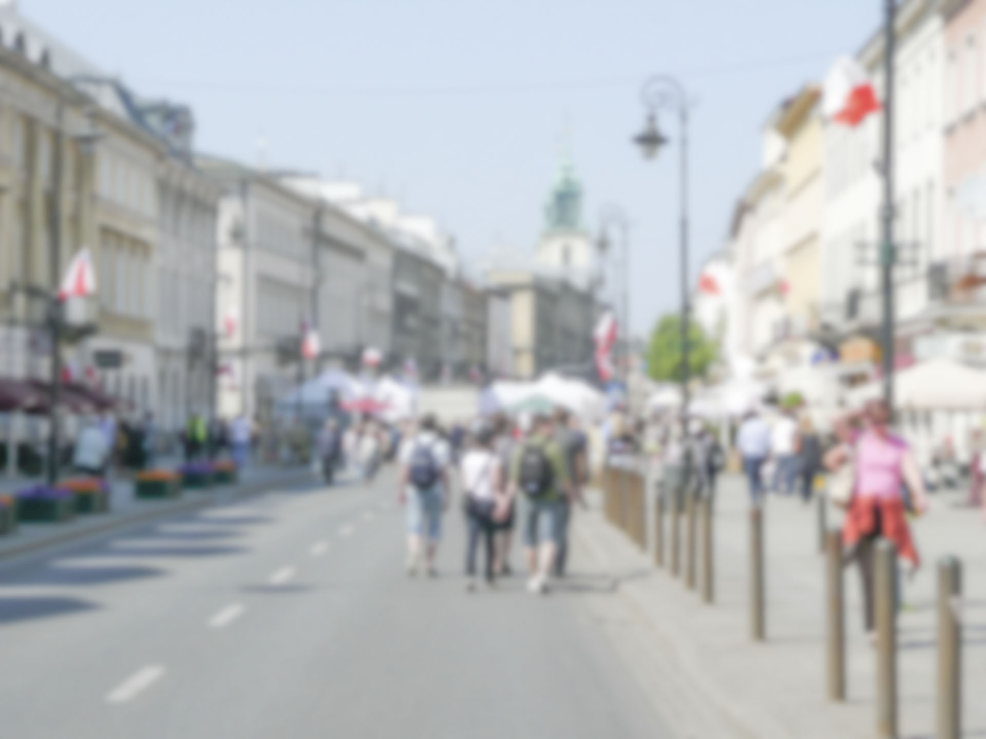 Defocused background of Nowy Swiat street in Warsaw, Poland