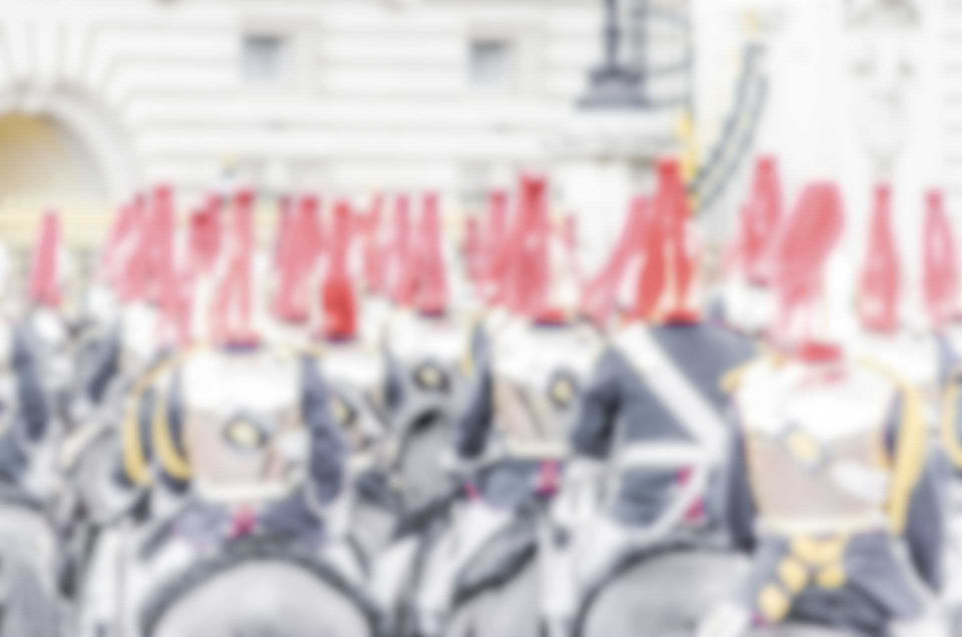 Defocused Background with british guards on parade in London. Intentionally blurred post production