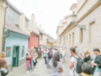 Defocused background of people walking in Prague
