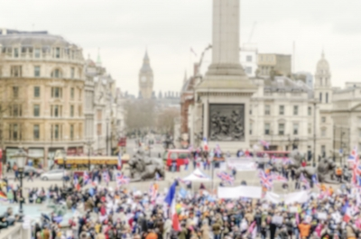 Defocused background of a crowded Trafalgar Square in London