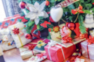 Defocused background of Christmas gifts with red packages