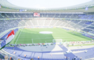 Defocused Background of Football Stadium. Intentionally blurred post production