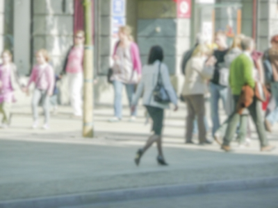 Defocused background of people walking in central Warsaw, Poland