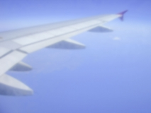 Defocused background of a plane wing during flight