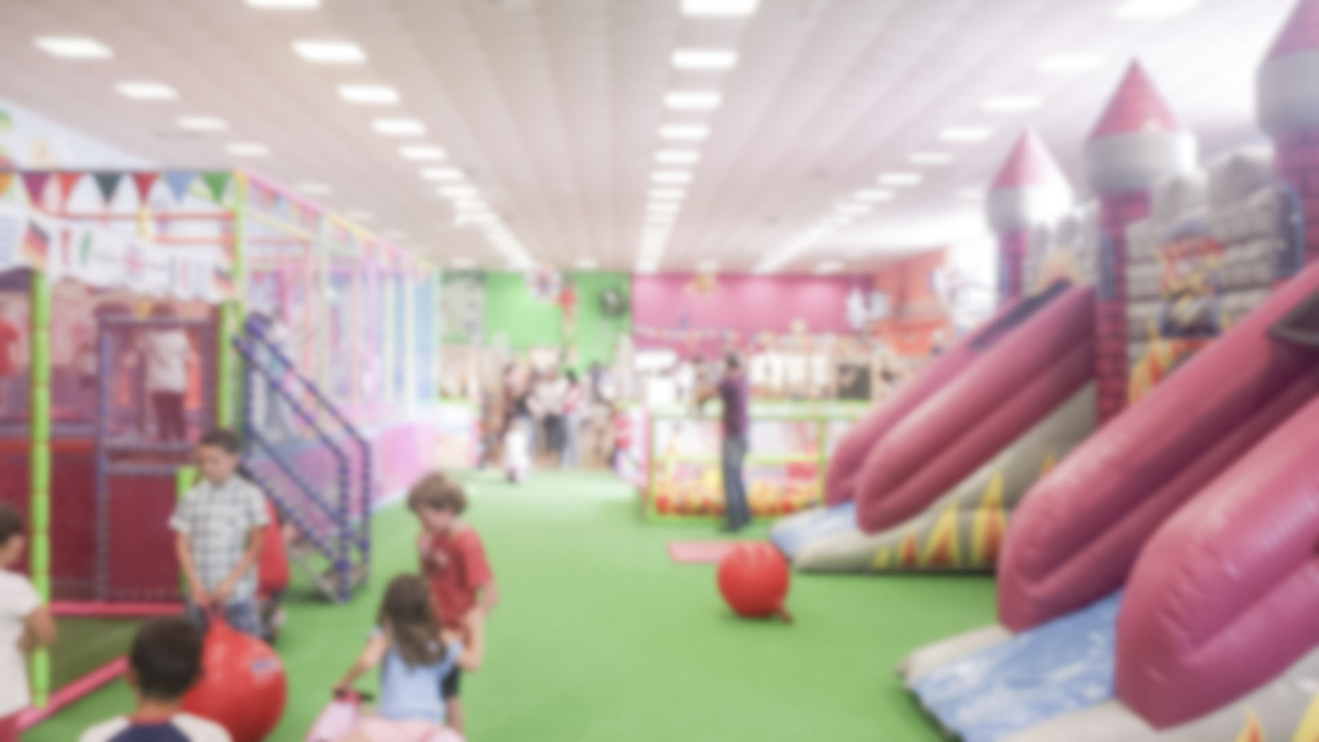 Defocused background of indoor children's public playground