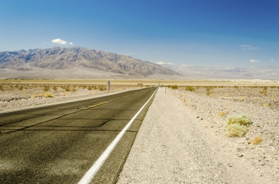 Hot desert road in Death Valley National Park, USA
