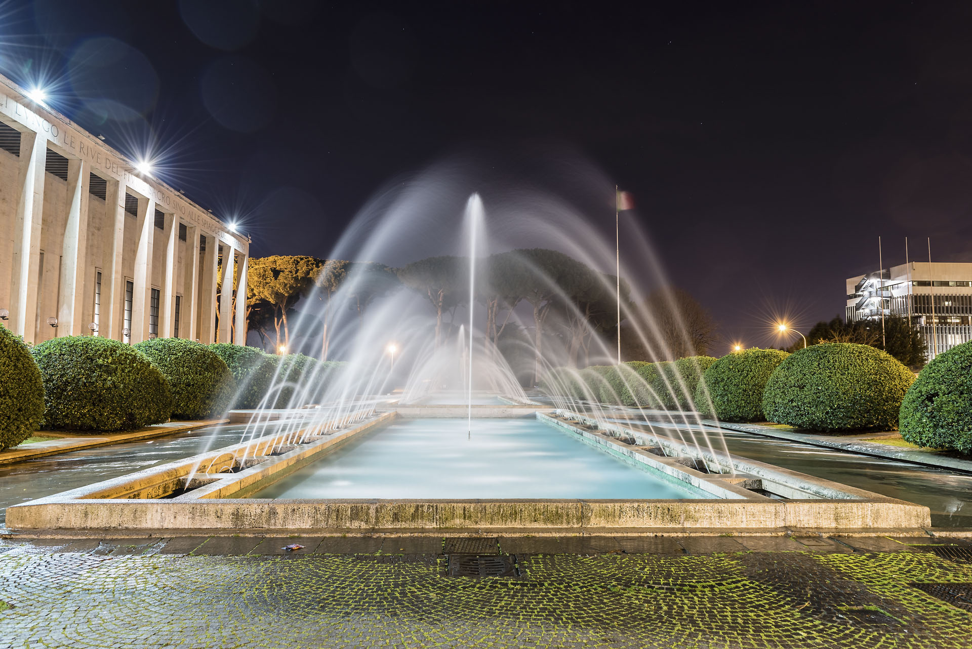 Scenic fountain, neoclassical architecture in the EUR district, Rome, Italy