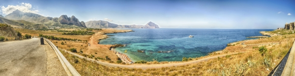 Panoramic aerial view over sicilian coastline and Cofano Mountain, San Vito Lo Capo, Italy