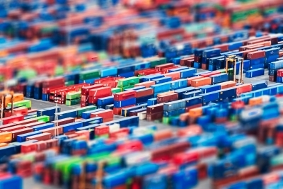 Aerial view over shipping containers stacked on a commercial port