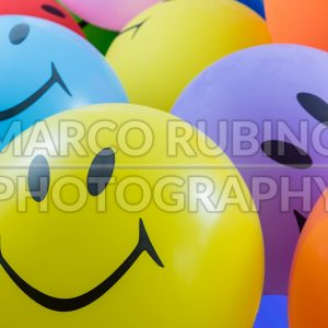 Colorful bunch of smiley balloons
