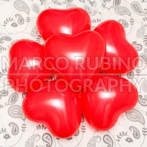 Composition of Red Heart shaped balloons on a blanket