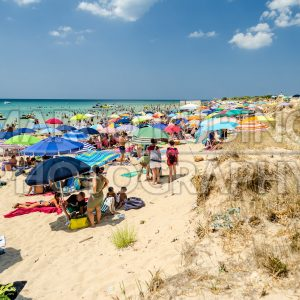 Crowded beach in Salento, Italy