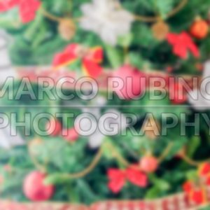 Defocused background of a Christmas Tree with red decorations