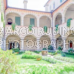 Defocused background of a cloister inside a villa in Italy