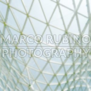 Defocused background of a glass roof structure of a shopping mall in Warsaw, Poland