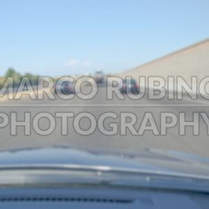 Defocused background of a highway seen from inside a car