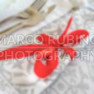 Defocused background of a red and white Christmas table setting
