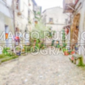 Defocused background of ancient italian small town