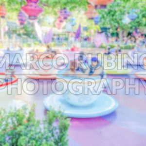 Defocused background of teacups attraction in amusement park