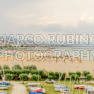 Defocused background with aerial view of adriatic beach in Italy