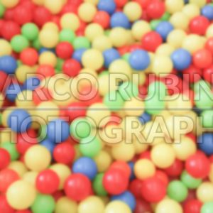 Defocused background with colorful plastic balls in children's playground pool