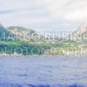 Defocused background with the island of Capri, Italy