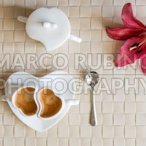 Flat lay with two cups of espresso coffee and flower