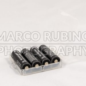 Four unbranded black AA rechargeable batteries in trasparent case