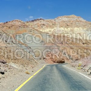 Isolated road among the rocks in Death Valley, USA
