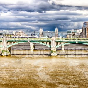 London cityscape with Tower Bridge over Southwark Bridge, UK