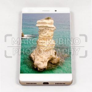 Modern smartphone displaying full screen picture of Apulia, Italy