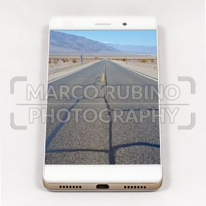 Modern smartphone displaying full screen picture of Death Valley, USA