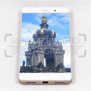 Modern smartphone displaying full screen picture of Dresden, Germany