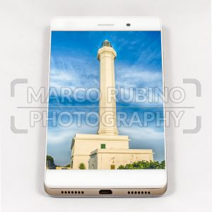 Modern smartphone displaying full screen picture of Leuca, Italy