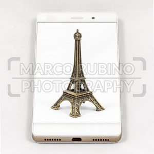Modern smartphone displaying full screen picture of Paris, France