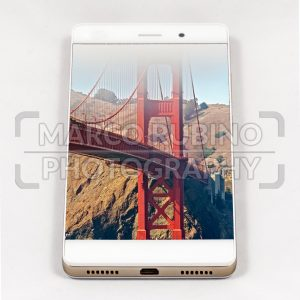 Modern smartphone displaying full screen picture of San Francisco, USA