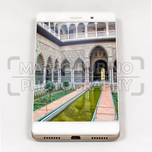 Modern smartphone displaying full screen picture of Seville, Spain