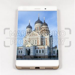 Modern smartphone displaying full screen picture of Tallinn, Estonia