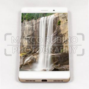 Modern smartphone displaying full screen picture of a waterfall