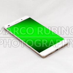 Modern smartphone with blank green screen, isolated on white background