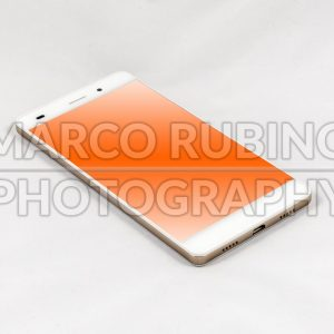 Modern smartphone with blank orange screen, isolated on white background