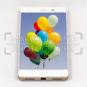 Modern smartphone with full screen picture of balloons on display