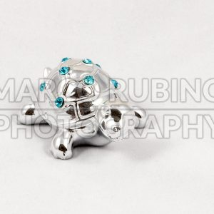 Ornamental silver turtle with gemstones