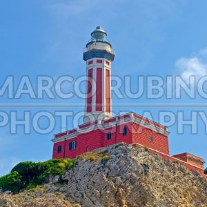 Red lighthouse seen on the island of Capri, Italy